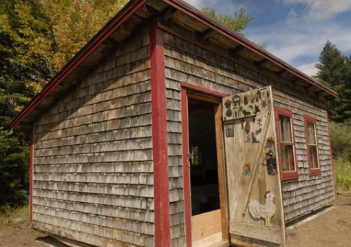 The Coop, the studio of the late award-winning writer Norbert Blei has found a new home behind the Write On building, 4177 Juddville Road in Juddville. It was moved to its new location Tuesday.(Photo: Tina M. Gohr/Door County Advocate)
