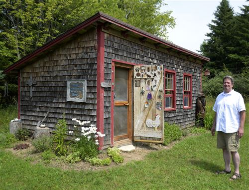 PHOTO BY BENJAMIN WIDEMAN Jerod Santek, executive director of Write On, Door County, stood outside the coop, a converted chicken coop located on the nonprofit organization's 39 acres of property.