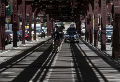 """Shadows of the """"L"""" tracks and CTA platforms overhead cover Wabash Avenue in the Loop on Wednesday. Many of Chicago's downtown elevated tracks were built around the turn of the last century. (Brian Cassella/Chicago Tribune )"""